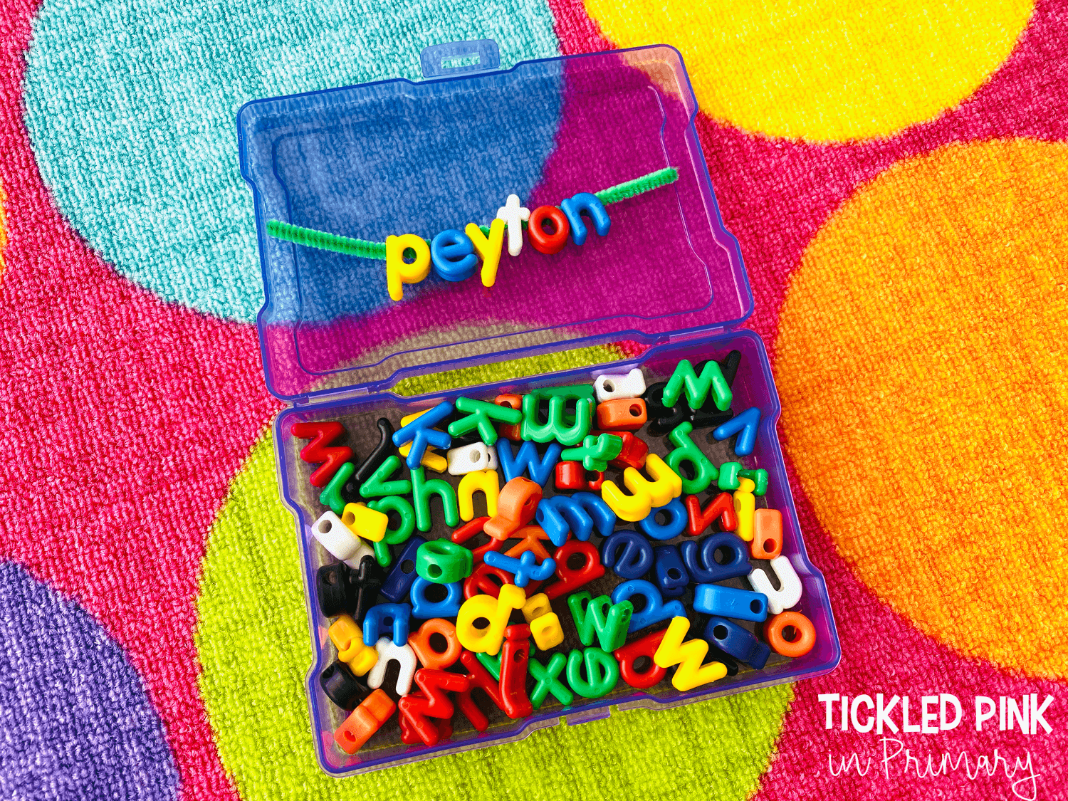alphabet beads in a box with the name Peyton spelled out