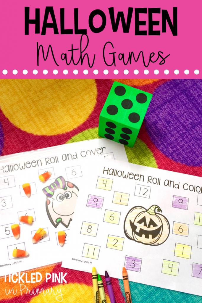 Halloween math center with dice and numbers on worksheets