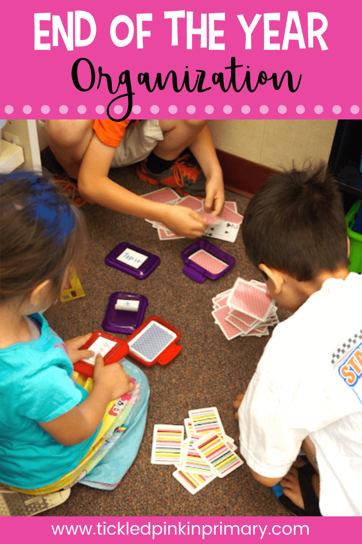 students organizing playing cards in containers for end of the year organization