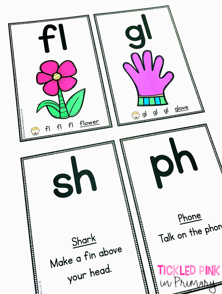 4 physical phonics cards laying on a table with blends and digraphs