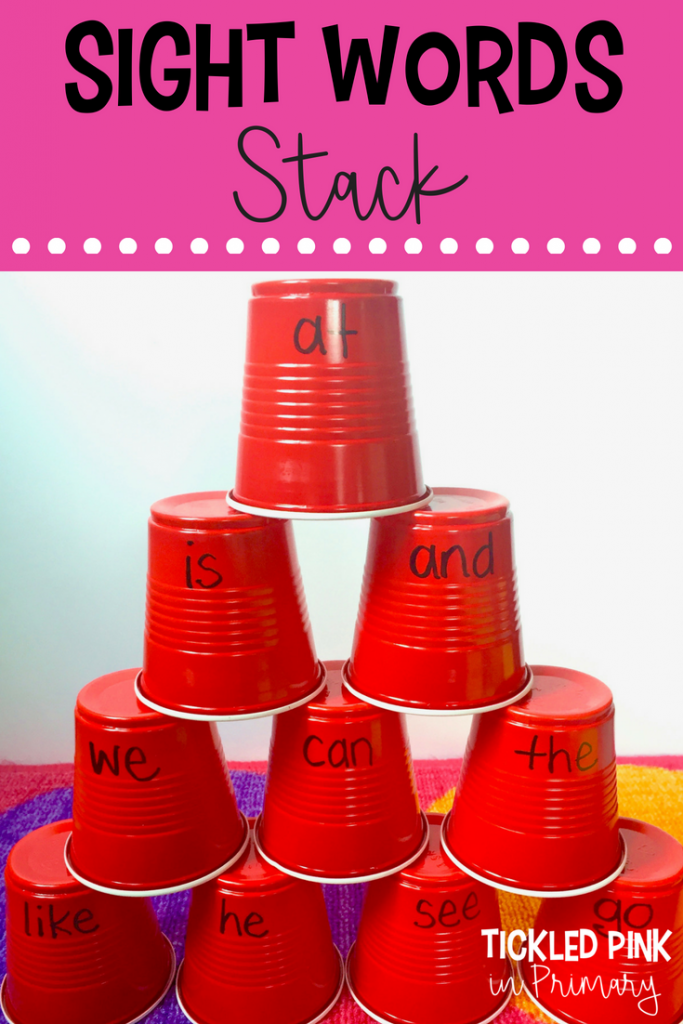 cups with sight words on them stacked in a tower