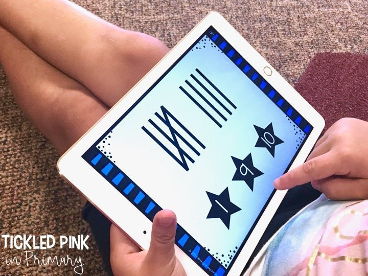 kid working on tally marks on iPad