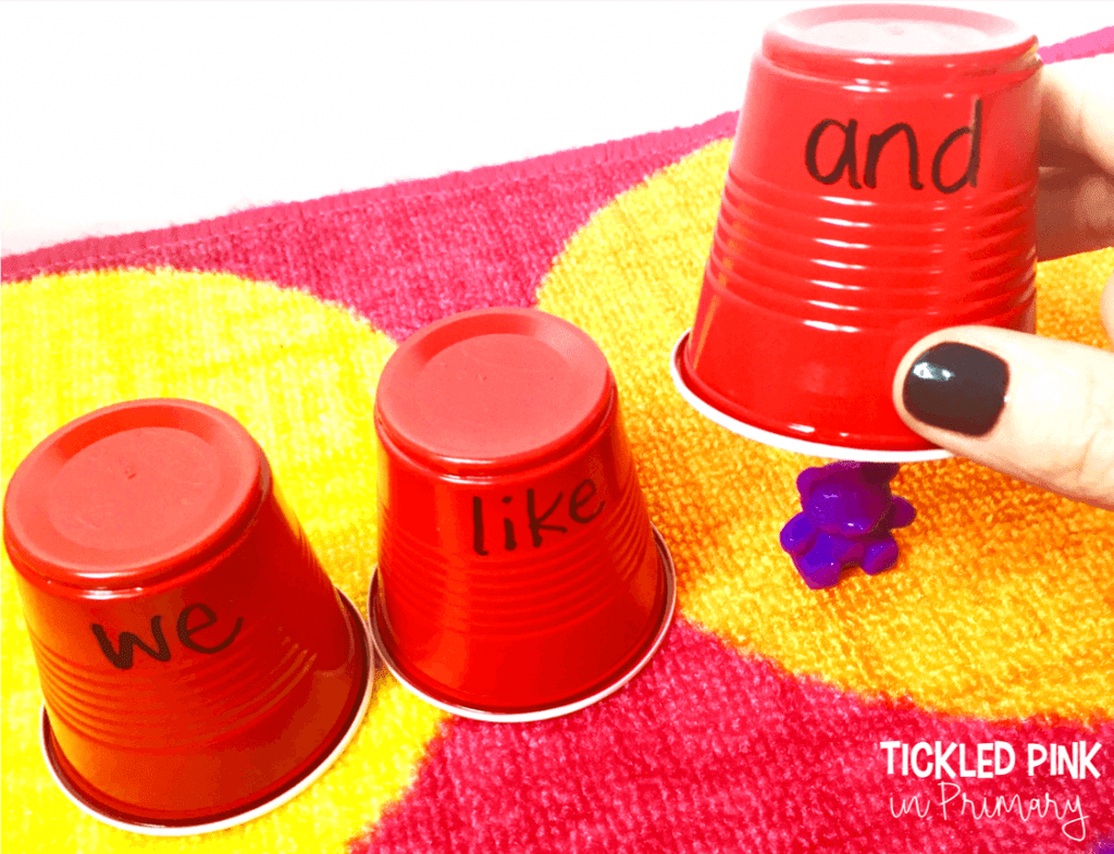 3 cups with sight words written on them, with 1 cup having a bear hidden underneath