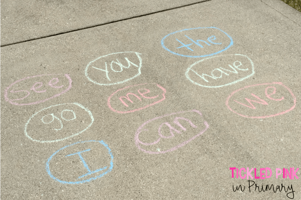 outdoor learning activities with sight words written in chalk