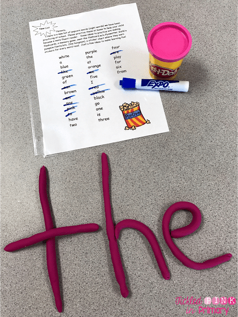 the word THE spelled out in pink playdoh next to al list of sight words